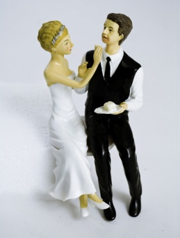 ''Bride and Groom Eating Cake'' - Humorous Figurine